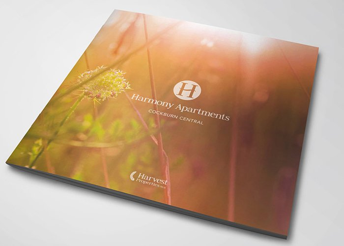 harmony apartments logo brochure image